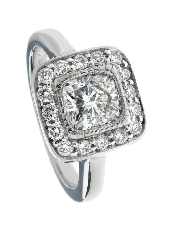 Cushion cut diamond engagement ring with pavé halo
